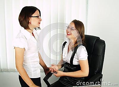 Two beautiful business women talking