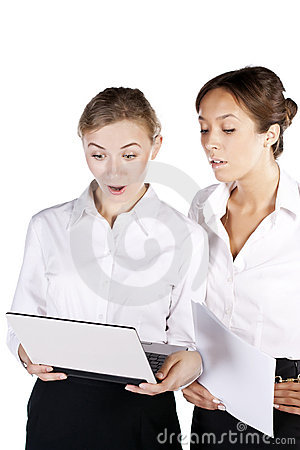 Two beautiful businesswoman working on the laptop