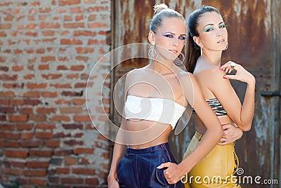 Two beautiful fashion women back to back