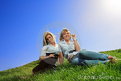 Two beautiful girl on the hill