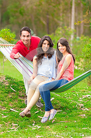 Free Two Beautiful Girls And A Young Man In Hammock Royalty Free Stock Images - 42636159