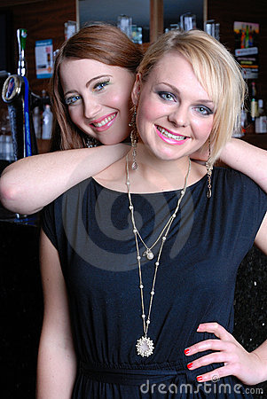 Two beautiful girls in bar