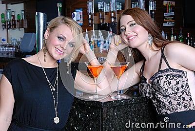 Two beautiful girls in bar