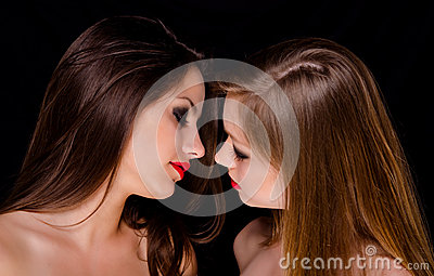 Two beautiful girls being intimate