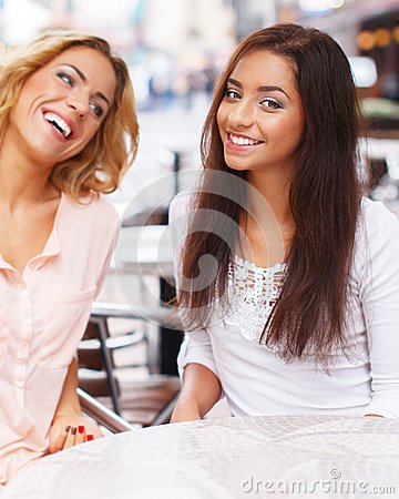 Two beautiful girls in cafe