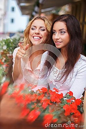 Two beautiful girls in cafe