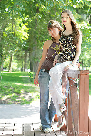 Two beautiful girls in city-park