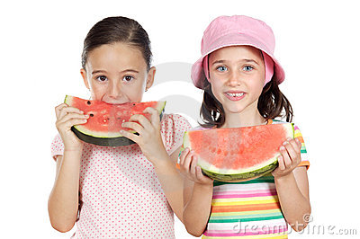 Two beautiful girls eating watermelon