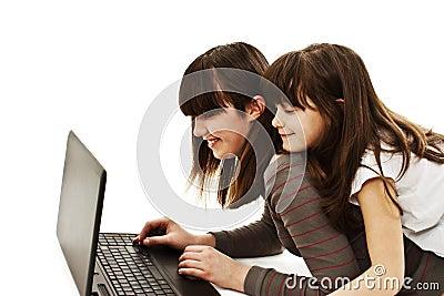 Two beautiful happy girls using a laptop