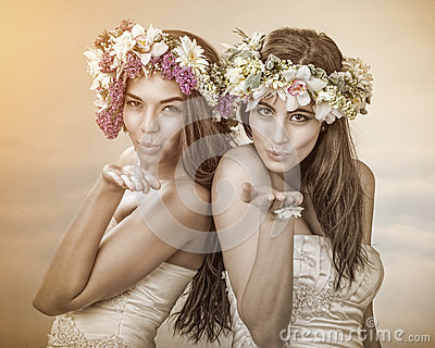 Two beautiful spring fairy , brides sending a kiss to you Stock Photo