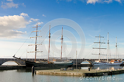 Two beautiful tall ships in a harbour