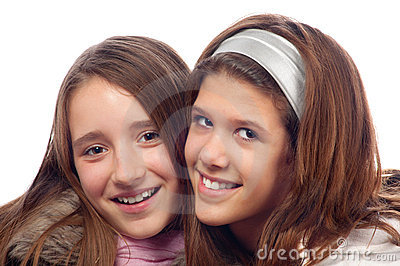 Two beautiful teenage girls smiling