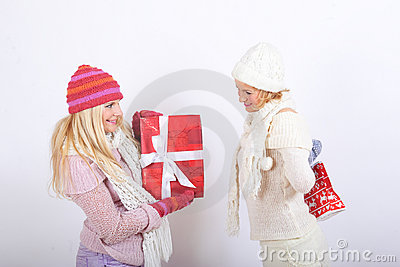 Two beautiful winter girls with christmas presents