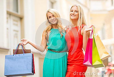 Two beautiful women with shopping bags in the ctiy