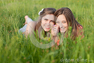 Two Beautiful young women outdoors happy smiling