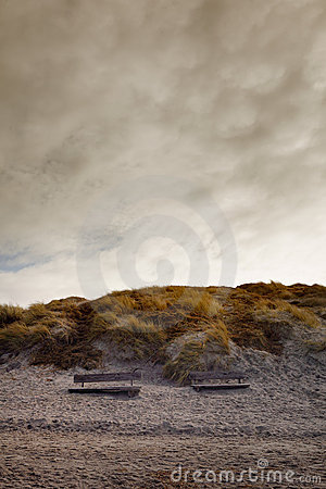 Free Two Benches At A Stormy Beach In The Sunset Royalty Free Stock Photo - 8302805