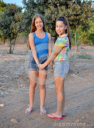 Best Friends Forever - two 12 Best Friends Holding Hands Girls