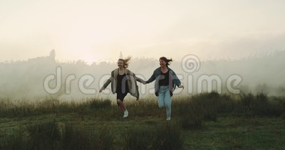 Two best friends having fun in the foggy atmosphere. Two best friends having fun in the foggy atmosphere stock video