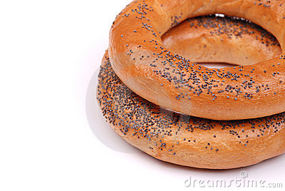 Two big bagels with a poppy