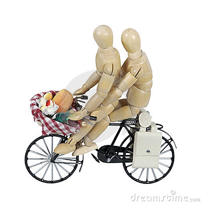Two on a Bike with a Picnic in a Basket