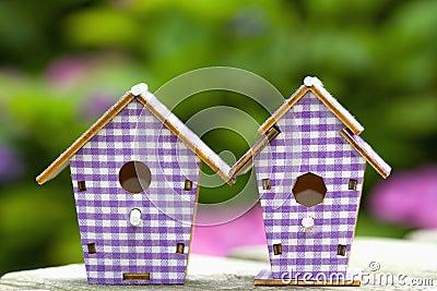 Two birdhouses in the garden