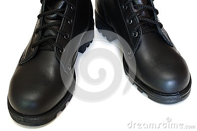 Two black leather army boots.