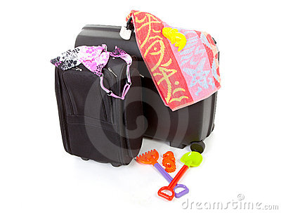Two black suitcases with beach gear