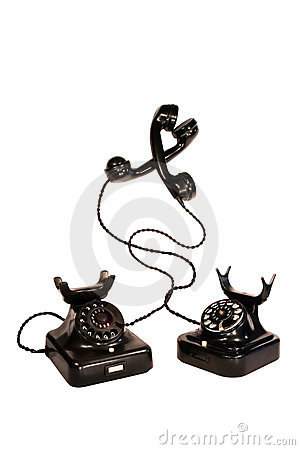 Two black vintage telephones entangled