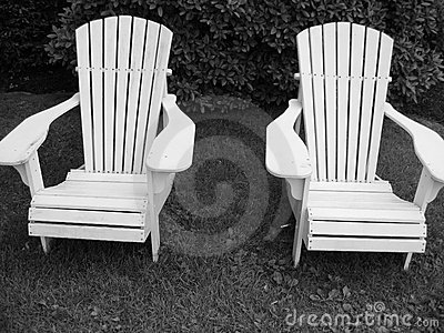 Two Black and White Adirondack Chairs