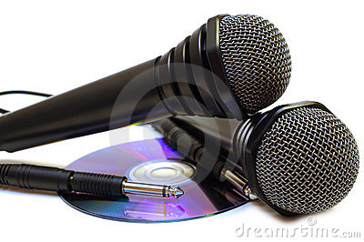 Two black wired karaoke microphones and CD.