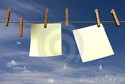 Two blank pieces of paper hanging on a rope