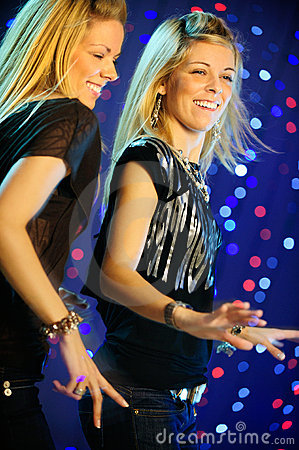 Two blond twins  girls dancing