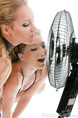 Two blonde woman under fan breeze