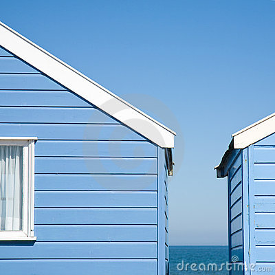 Two blue beach huts