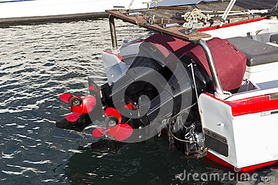 Two boat engines with red props