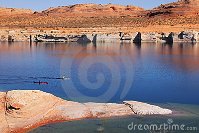 Two boats with oars float in the water