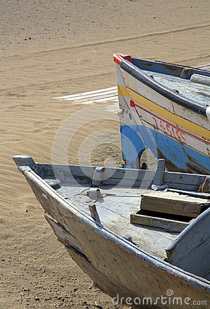 Two boats on sandy beach