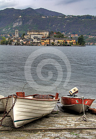 Two boats on the shore of lake Orta