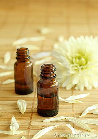 Two bottles of essence oil and chrysanthemum.