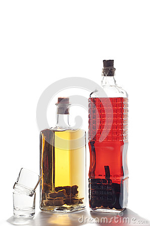 Two bottles of homemade liquor isolated on white