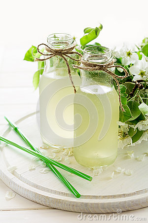 Free Two Bottles Of Apple Cider Decorated Pear Blossom. Selective Focus Stock Image - 70673831