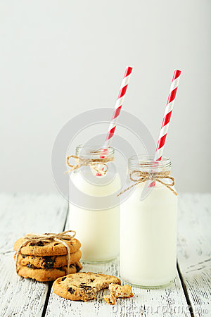 Free Two Bottles Of Milk With Striped Straws And Cookies On The White Wooden Background Royalty Free Stock Photo - 49670255