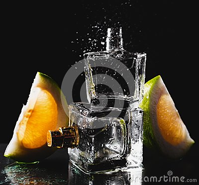 Free Two Bottles Of Perfumes With Citrus Stock Photography - 102811152