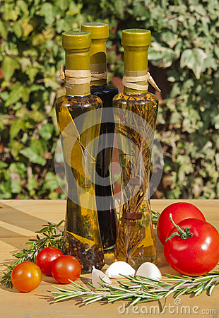 Oil and vinegar bottles in a sunny garden