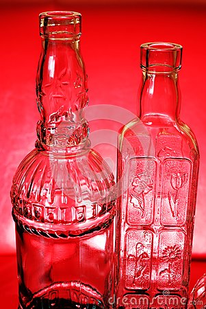 Two bottles on red