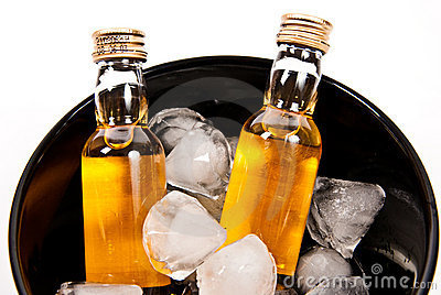 Two bottles of rum with ice cube