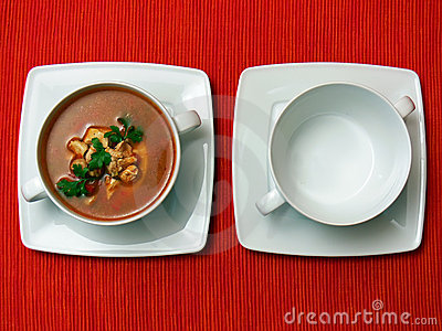 Two bowls on red fabric