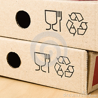 Two boxes of pizza with the recycling symbol.