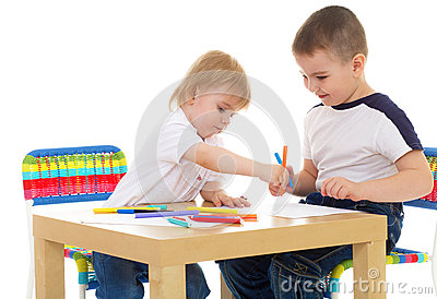 Two boys enthusiastically paint markers Stock Photo