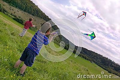 Two boys with kites.